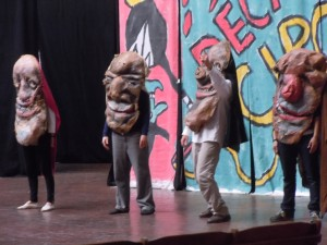 Puppet-headed actors on stage: Bread & Puppet Theater