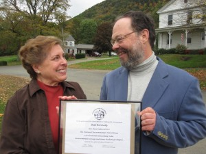 Shel Horowitz receives his membership in the National Environmental Hall of Fame from Judith Eiseman