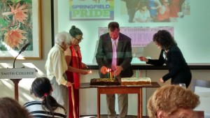 Arky Markham, 100, watches as (from left) Marty Nathan, Mayor David  Narkewicz, and Lisa Baskin light birthday candles