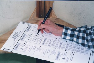 A voter marks a ballot. Photo by Kristen Price.