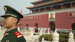 A guard stands near the Gate of Heavenly Peace and its giant picture of Mao. Photo by D. Dina Friedman.