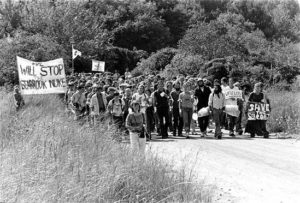 Nonviolent occupiers approach the construction site of the Seabrook nuclear plant, April 30, 1977. Unattributed photo found at https://josna.wordpress.com/tag/anti-nuclear-movement/