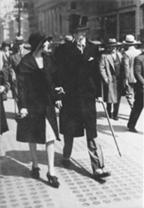 "Edward Bernays' secretary Bertha Hunt smokes in public at Bernays' 1927 ""Torches of Freedom"" march"