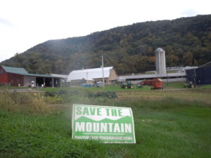 Lawn sign from the Save the Mountain campaign in Hadley, MA, in front of Mount Holyoke (a state park next to the mountain we saved)